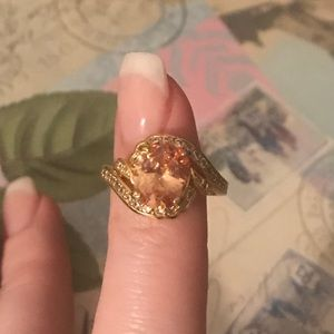 Jewelry - Gold ring with peach colored stone